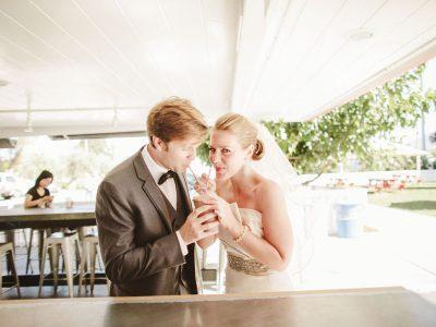 bride and groom share a shake